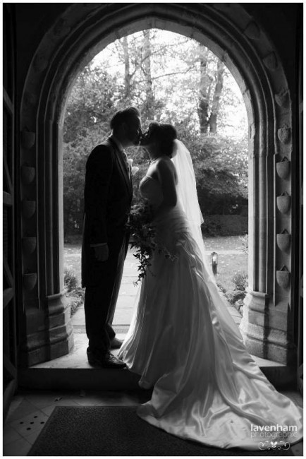 Photography of Bride and groom in church doorway after wedding ceremony at Hengrave Hall's church