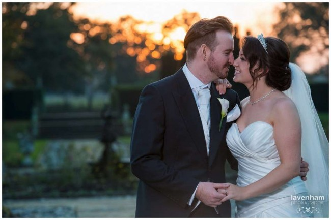 Photography of bride and groom with sunset behind