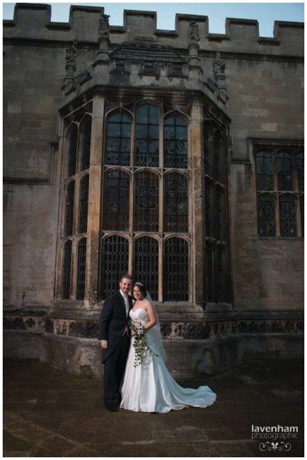 Photography of Bride and groom in front of large window