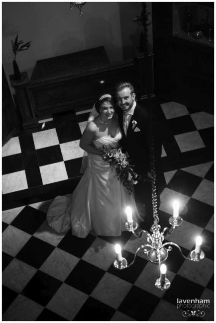 Black and White Photograph of Bride and Groom in the small chapel at Hengrave Hall