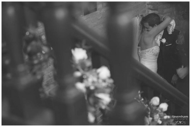 Black and white photo of Bride and groom on staircase at Leez priory