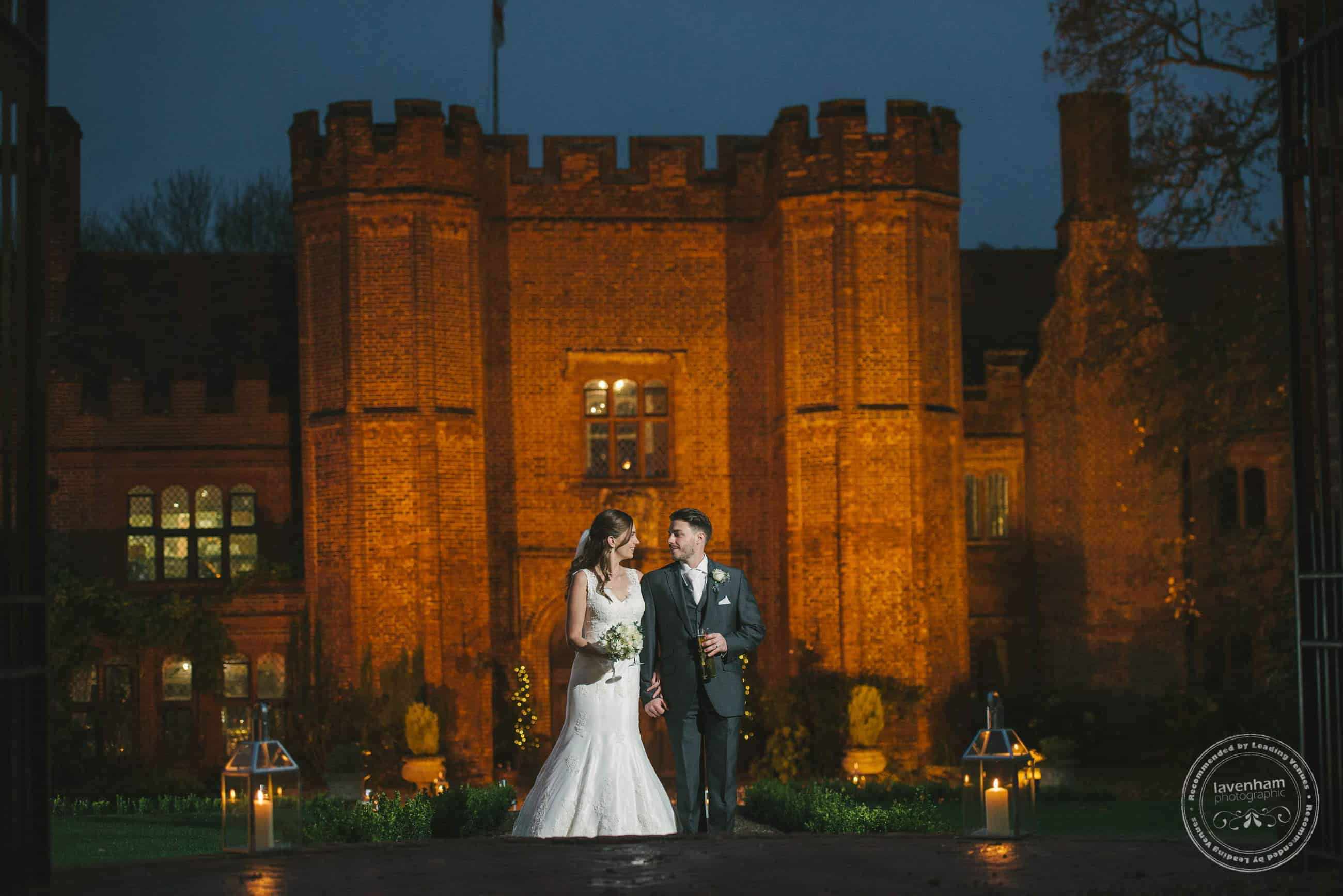 A night time wedding photograph, the bride and groom in front of Leez Priory, lit by off-camera flash