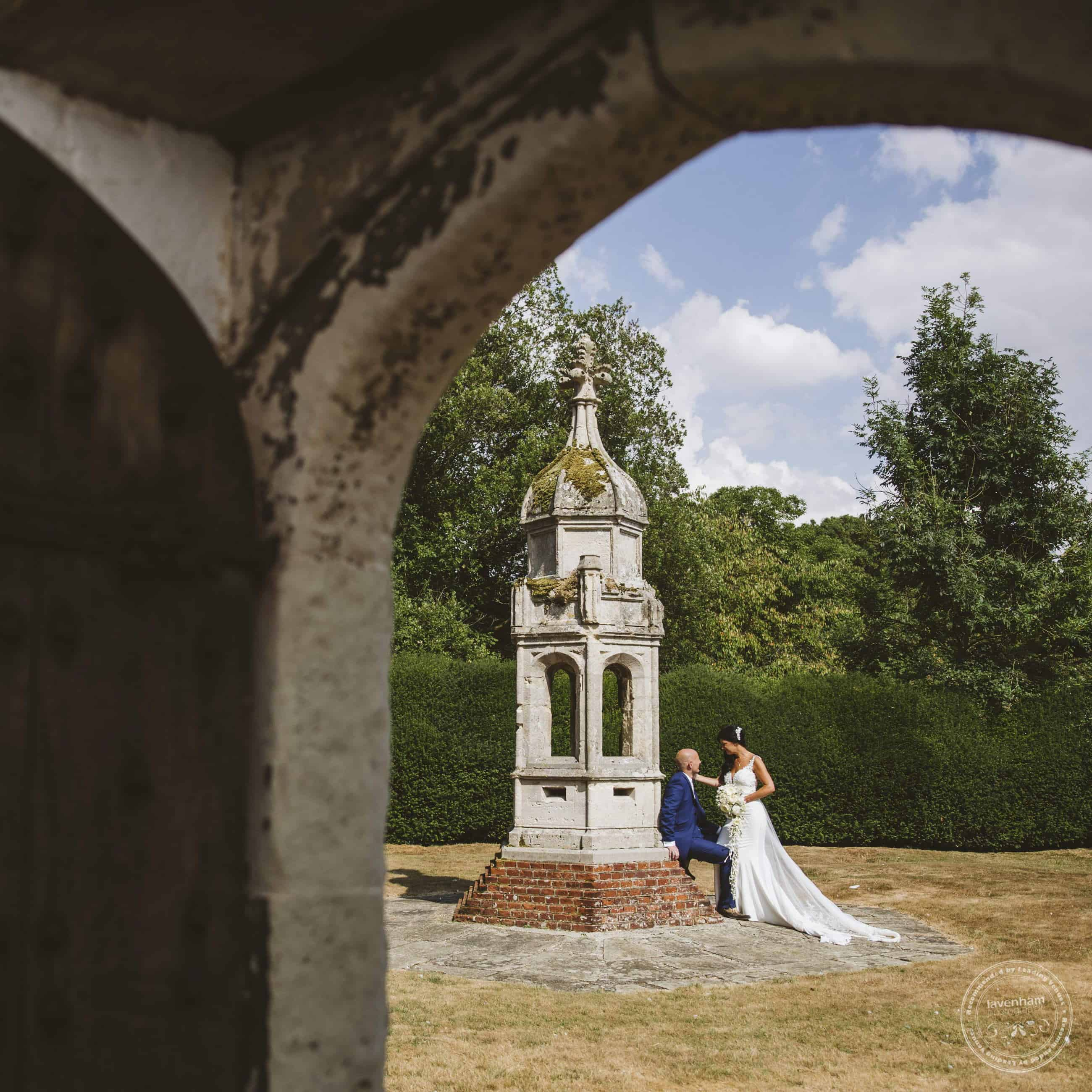 Framing a wedding photograph through a doorway arch