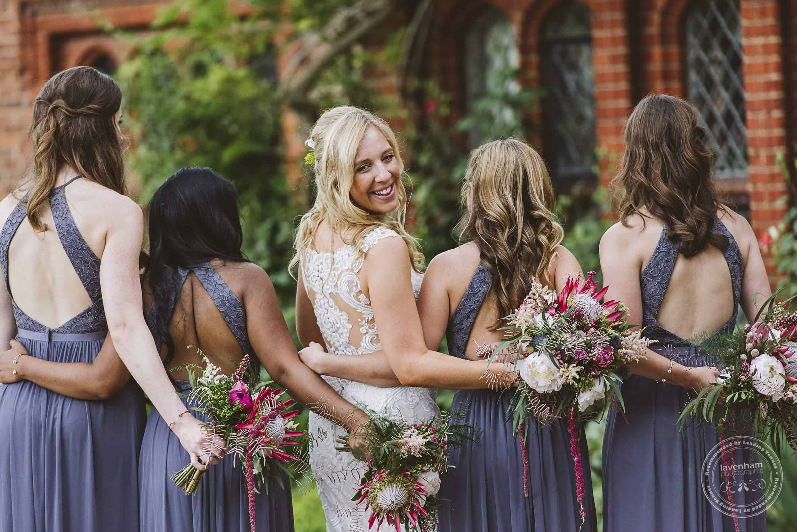 Bride, with her bridesmaids. This photo shows off the bouquets, bridesmaids dress colours, and the girl's hair