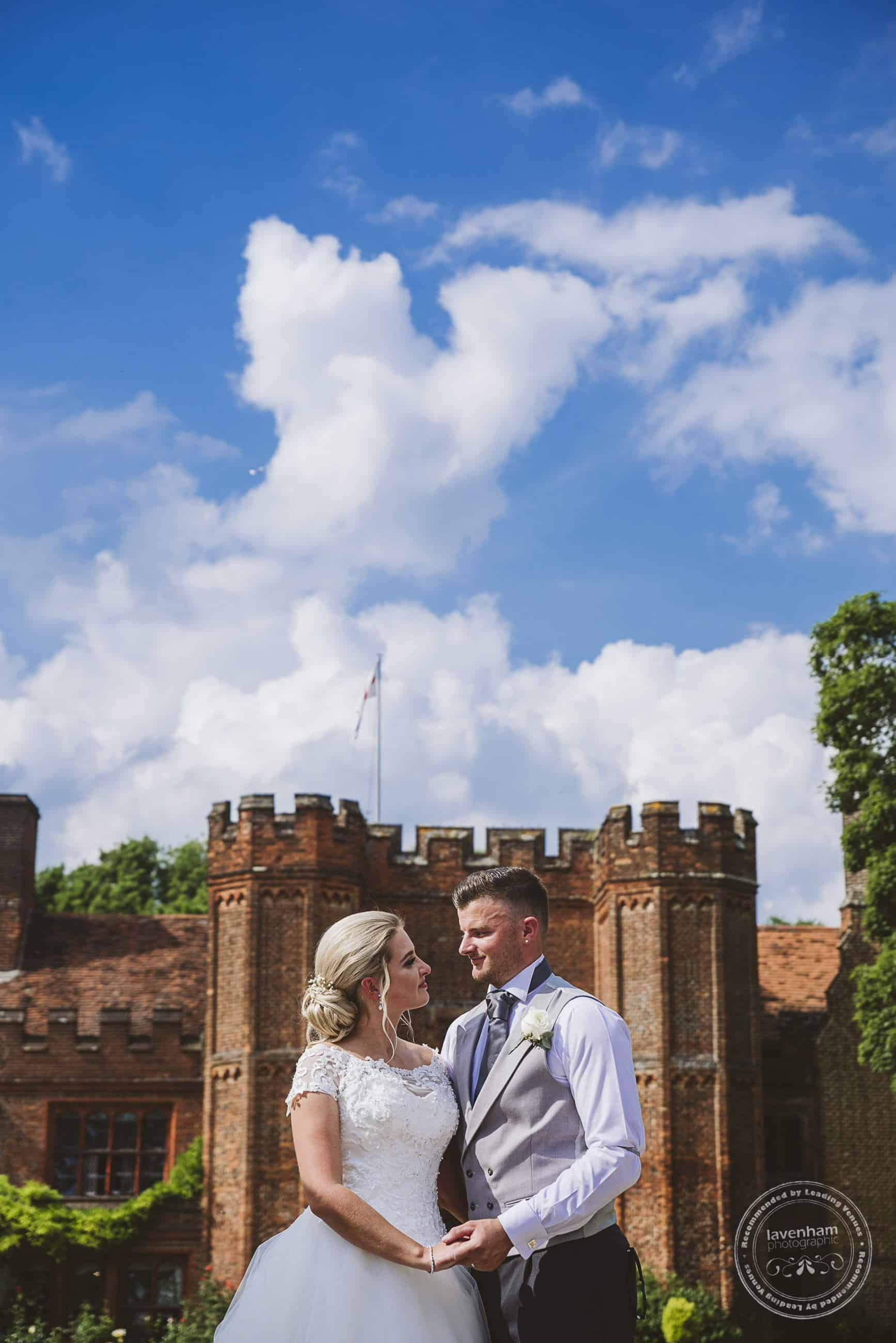 Wonderful blue sky over Leez Priory, a dramatic composition with the bride and groom low in the frame