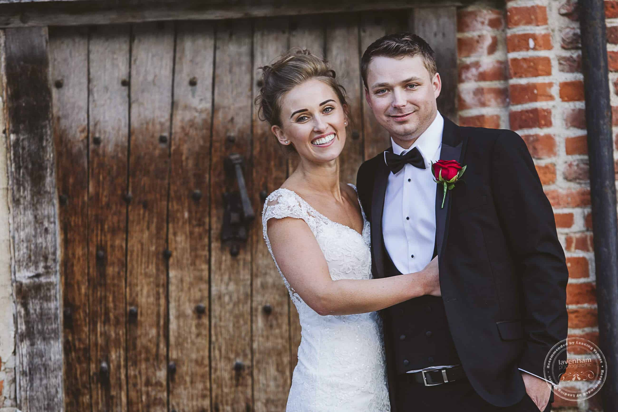 Relaxed, comfortable posing of the bride and groom in front of one of the lovely old wooden doors at Leez Priory. There's so much texture at Leez!