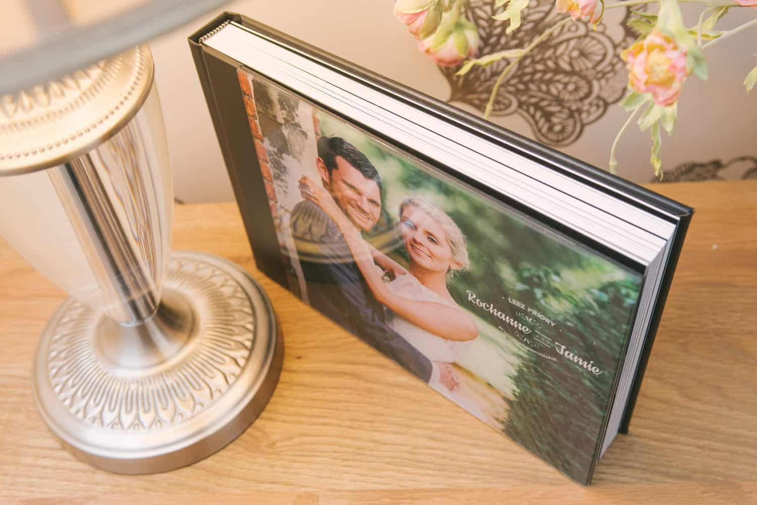 Standard wedding album with black leatherette and acrylic cover