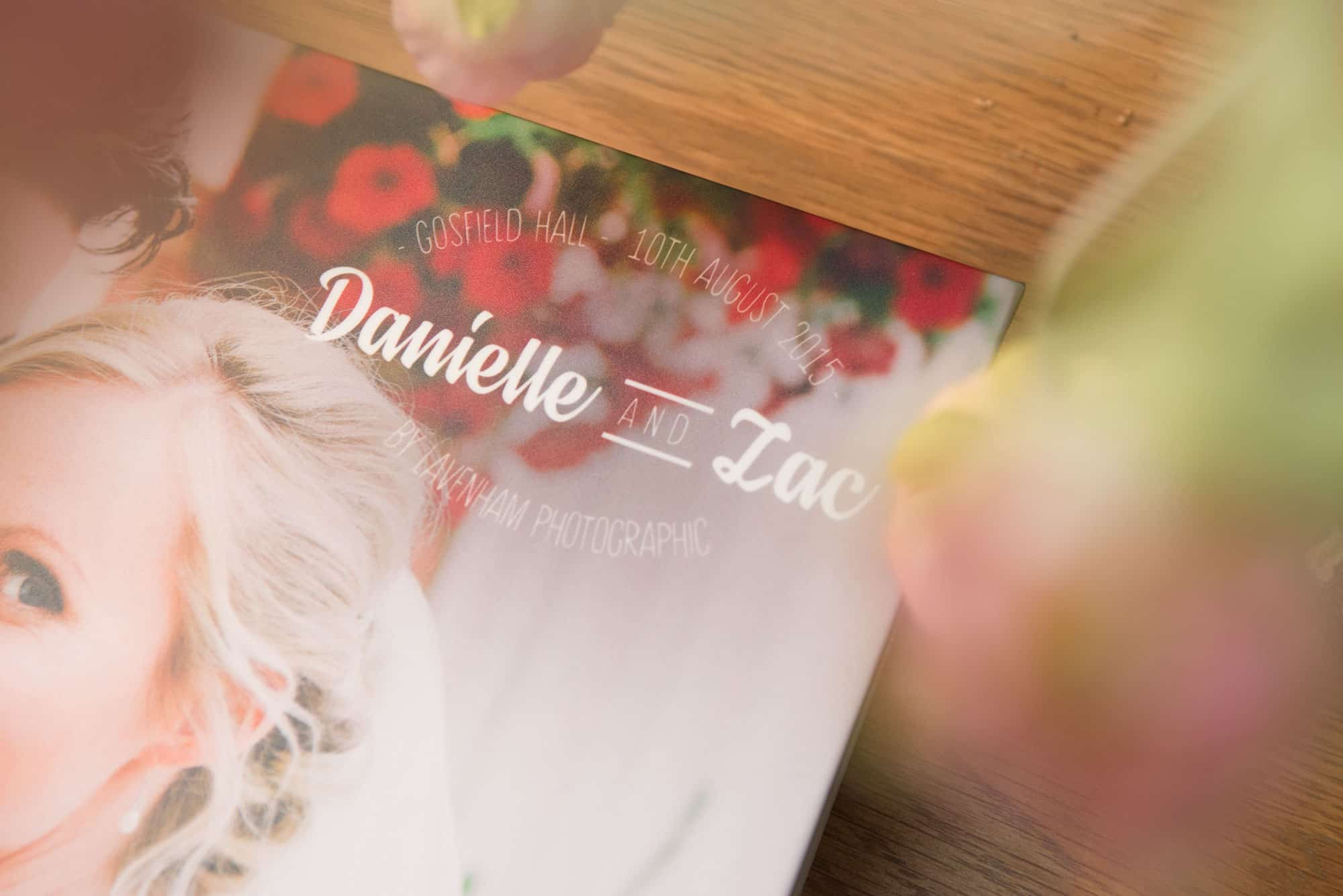 Close up of the design of bride and groom's name on the front of a wedding album
