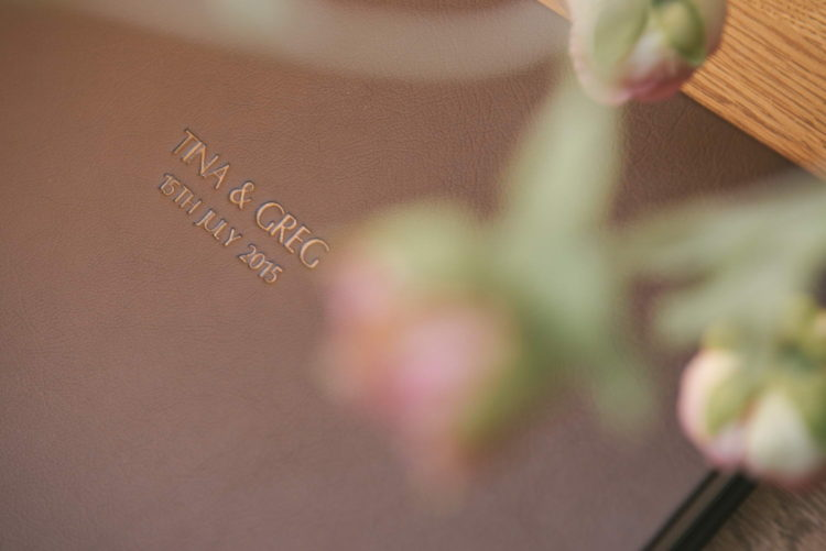 Close up of the embossed words on a brown leather wedding album cover