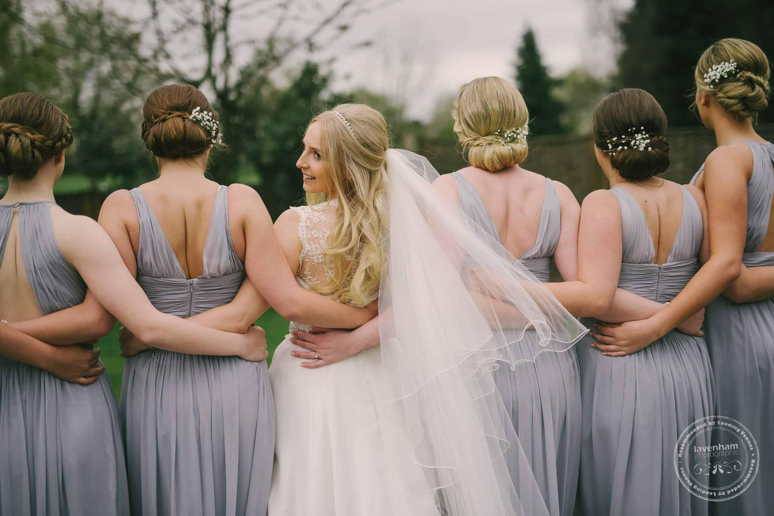 Bride, with her bridesmaids. This photo shows off the bridesmaids dress colours and the hairdo's of the girls