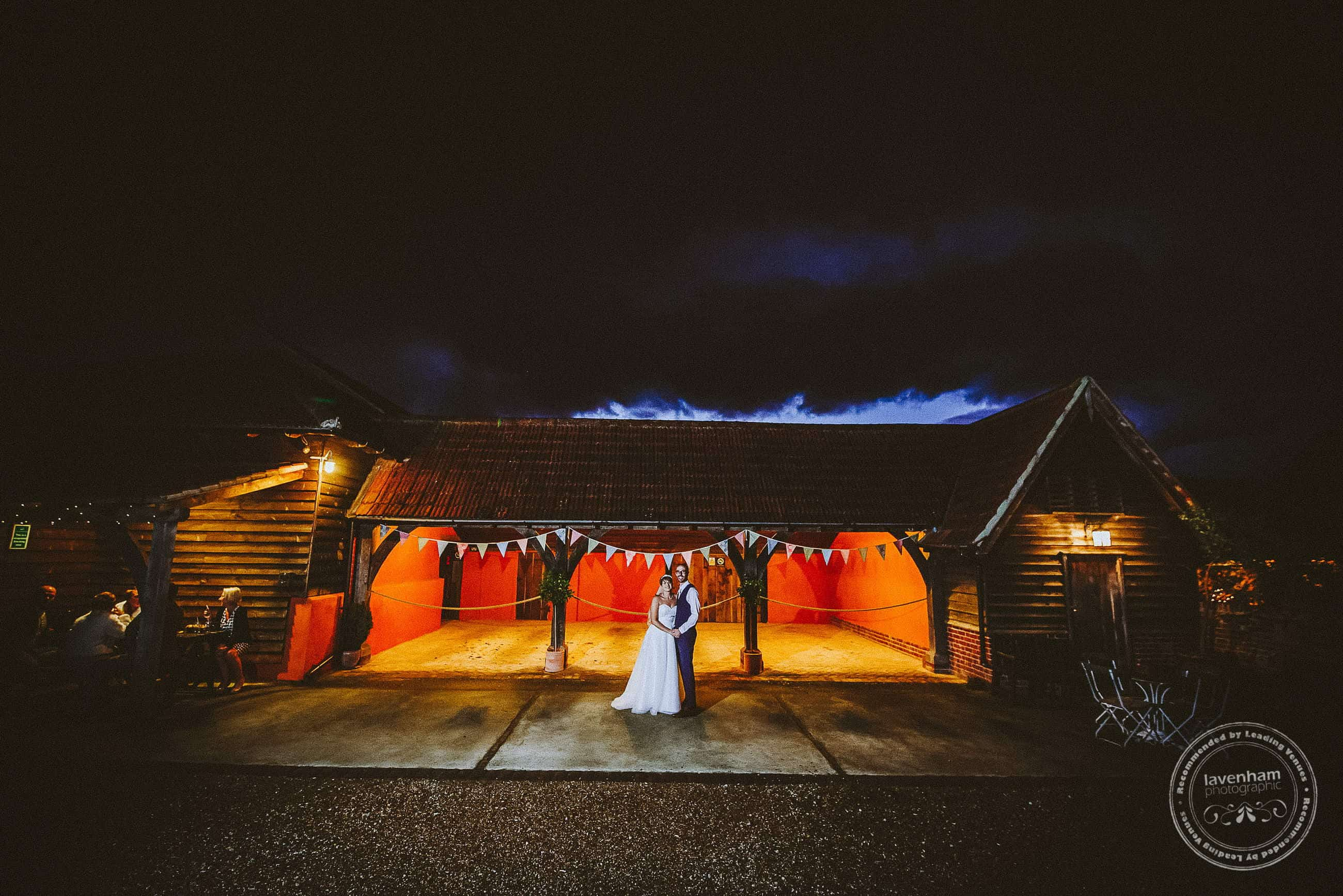 A very dramatic wedding photograph - the bright orange colour inside the cart lodge at Moreves barn. photographed with off-camera flash