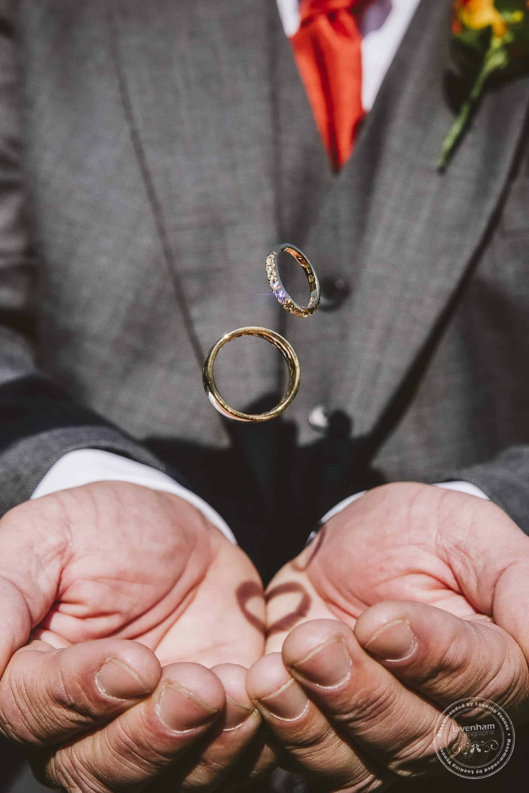 This photo is a great way of showing the ring details, with a background of the wedding suit's colours. An added bonus in this example is the heart-shape made by the shade falling on the hands!