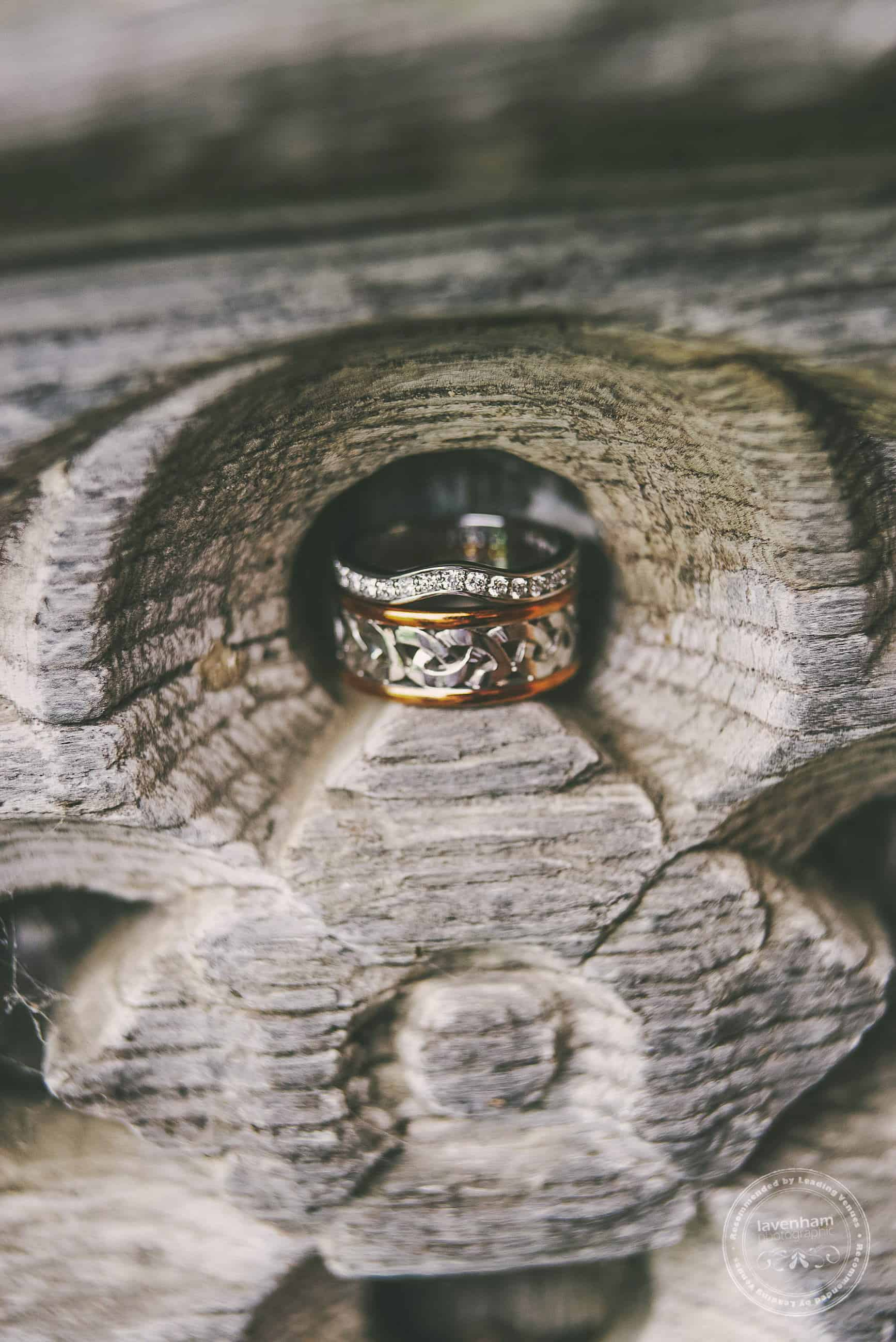 The wonderful carved details in one of the old doors at Leez Priory are just perfect for sitting wedding rings in for a detail photograph. Especially good when the wedding rings have this much detail!