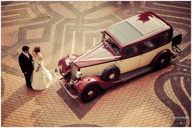 Overhead wedding photo of bride and groom with wedding car, on the maze paving at Kentwell Hall